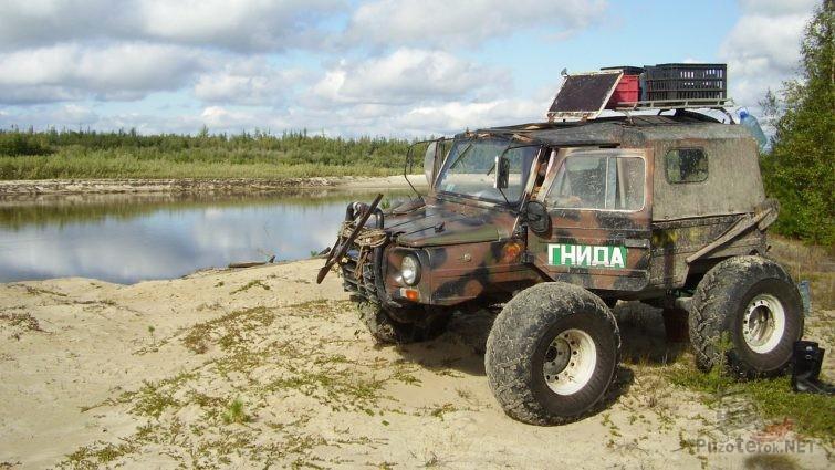 Луаз рыбака на больших колёсах