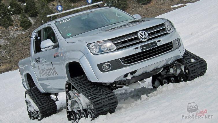 Амарок на гусеницах едет по снегу