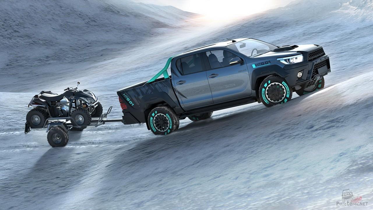 Toyota Hilux везёт квадроцикл на прицепе