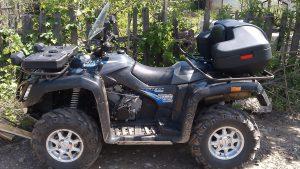 Квадроцикл Stels ATV 700 max у забора