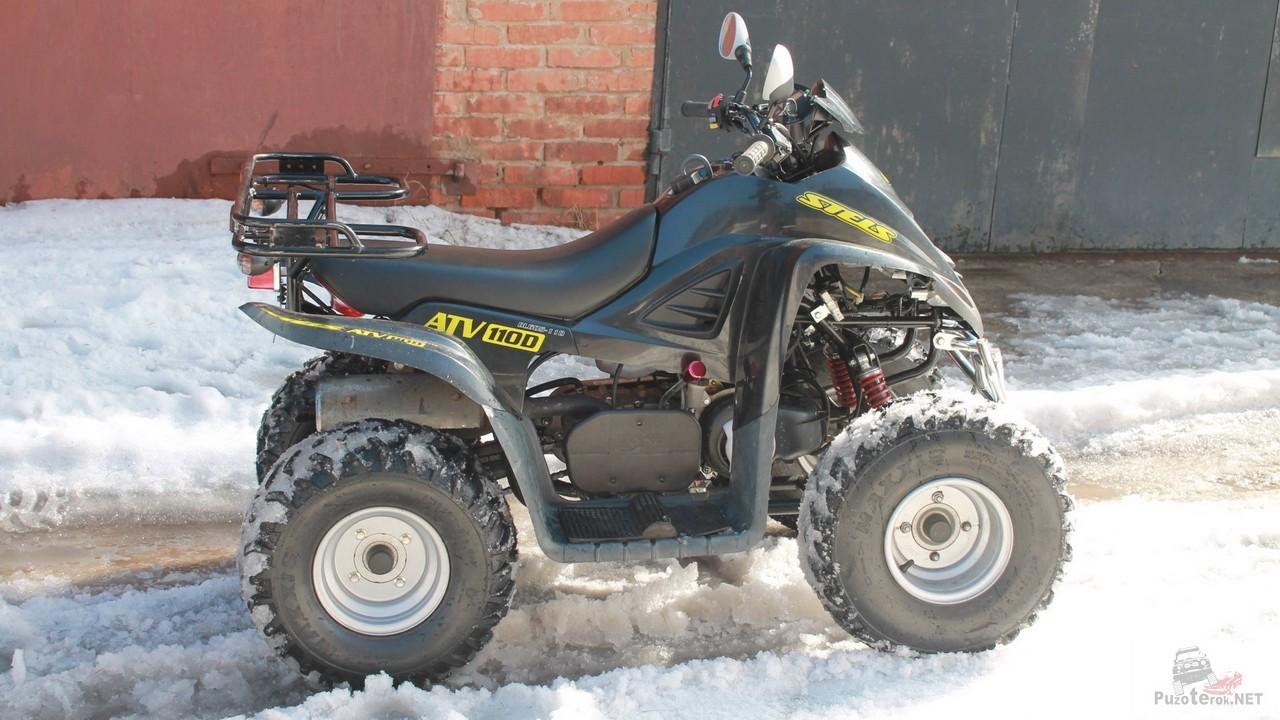Детский Stels ATV 110D у гаражей